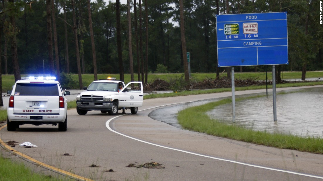 Officials close down an exit off Interstate 55 south in Independence as floodwaters creep closer to the highway on August 13.