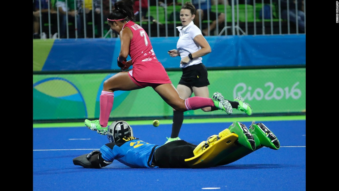 Field hockey player Aki Mitsuhashi of Japan, top, fights for the ball with Australia's goalkeeper Rachael Lynch during their preliminary match.