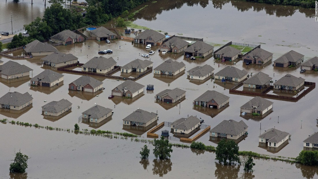 An aerial view of flood-damaged homes in Hammond on August 13.