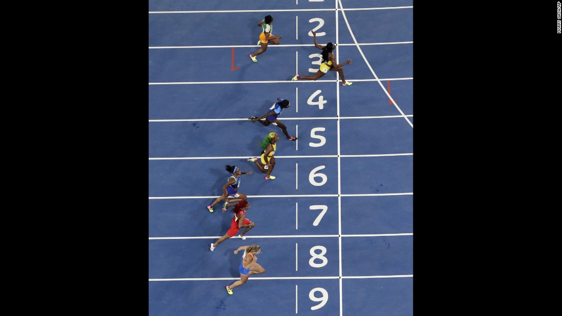 Jamaica's Elaine Thompson, second from top, wins the 100-meter final on Saturday, August 13. Third-placed teammate Shelly-Ann Fraser-Pryce fell short in her bid to win the event for a record third successive Olympics.