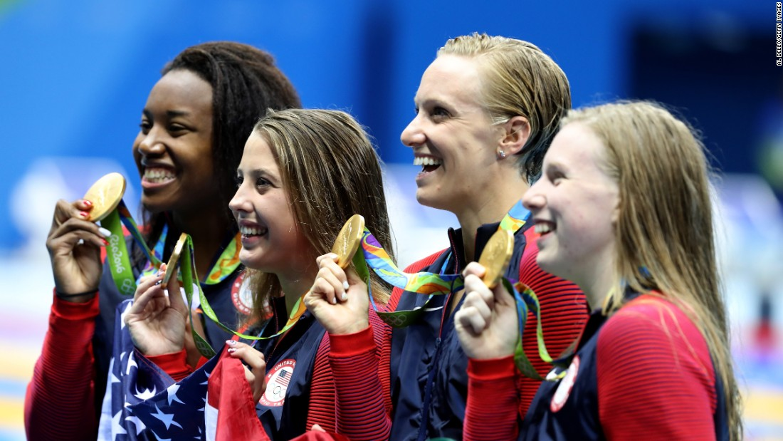 Simone Manuel, Kathleen Baker, Dana Vollmer and Lilly King of the US swim team pose with their gold medals after winning the 4x100-meters medley relay.