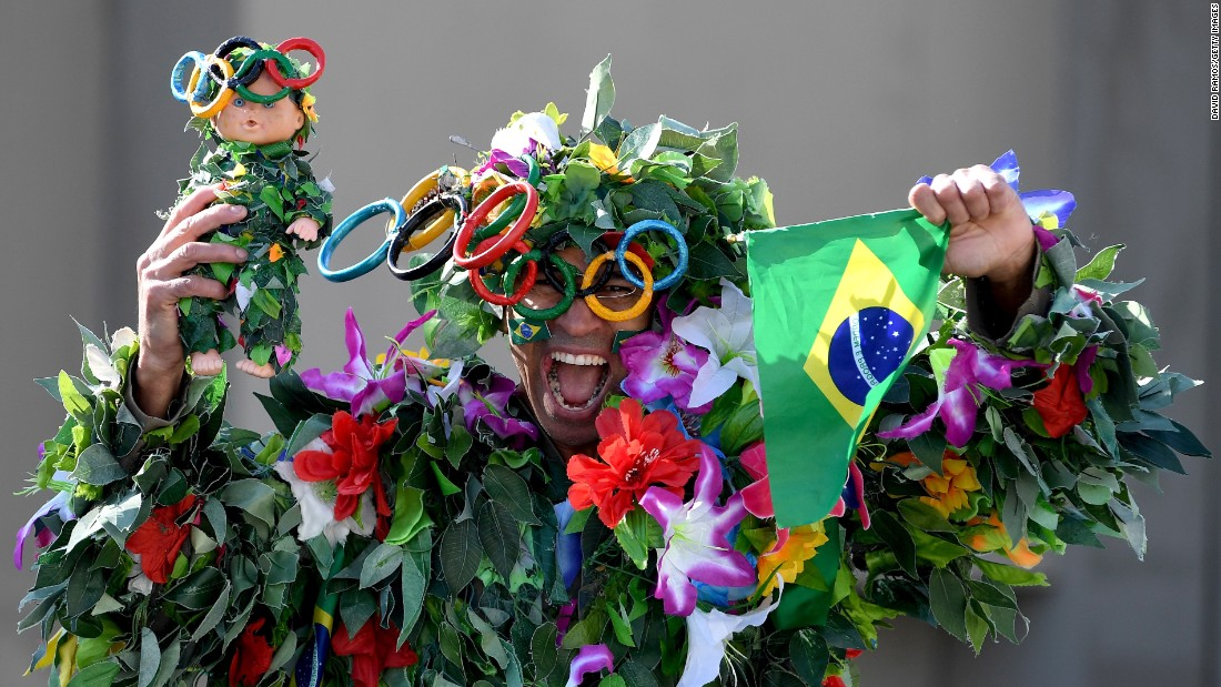 A Brazilian fan cheers before the start of the Women's Marathon.