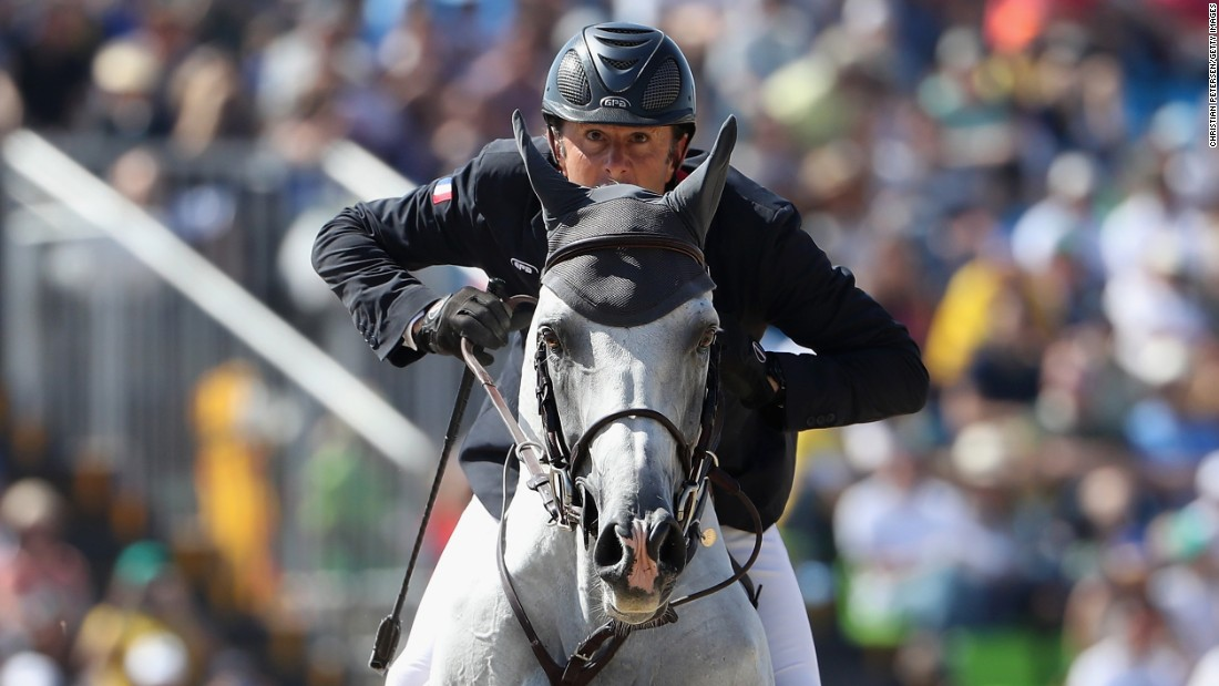 Philippe Rozier of France, riding Rahotep De Toscane, looks ahead during the Jumping Individual and Team Qualifier.