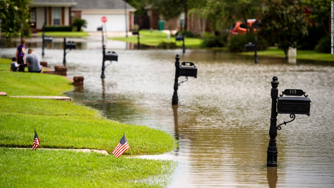 Floodwaters inundate a street in Youngsville on August 14.
