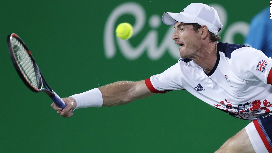 Andy Murray returns to Juan Martin del Potro of Argentina in the men's tennis final. The British player retained his title.