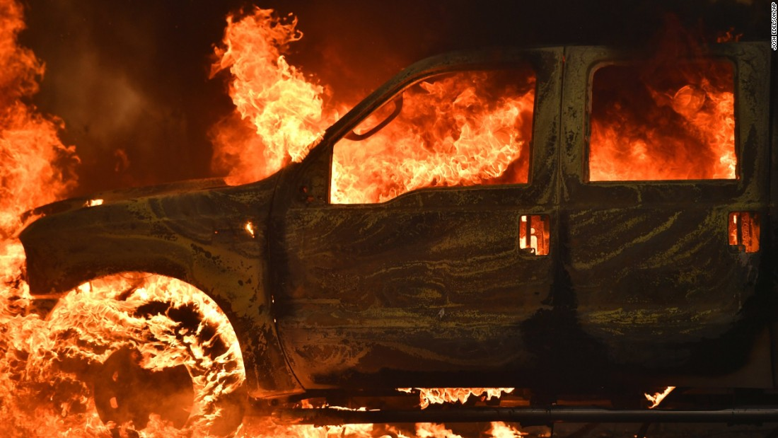 A truck burns on Main Street in the town of Lower Lake, California.