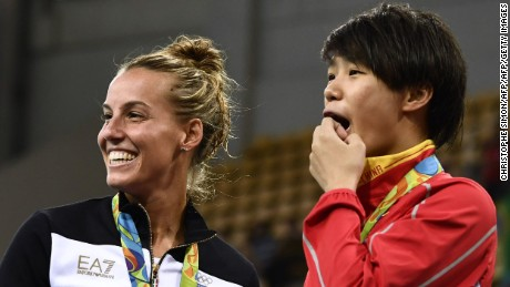 China's gold medalist Shi Tingmao (R) reacts with third-placed Tania Cagnotto of Italy.