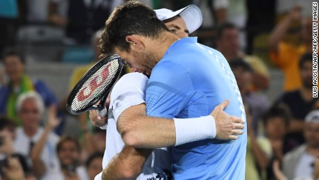 Argentina's Juan Martin Del Potro congratulates Britain's Andy Murray on winning the men's singles gold medal tennis match at the Olympic Tennis Centre of the Rio 2016 Olympic Games in Rio de Janeiro on August 14, 2016. / AFP / Luis Acosta        (Photo credit should read LUIS ACOSTA/AFP/Getty Images)