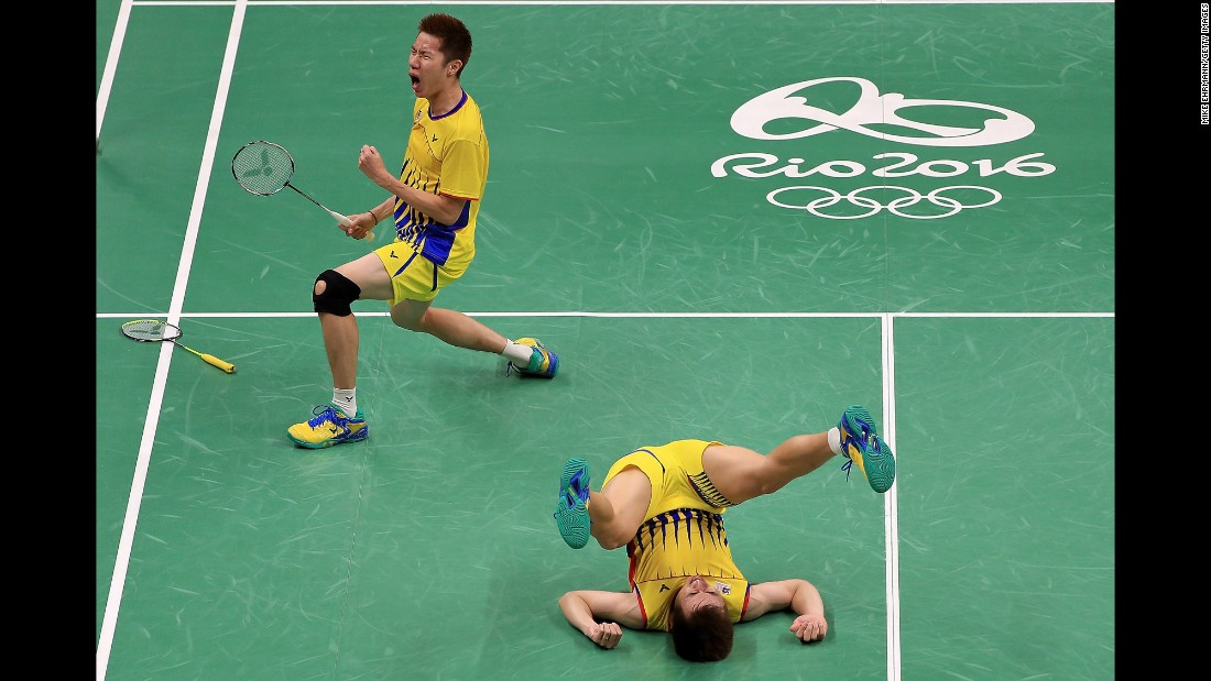 Goh V Shem and Tan Wee Kiong of Malaysia celebrate after winning a quarterfinal badminton match.