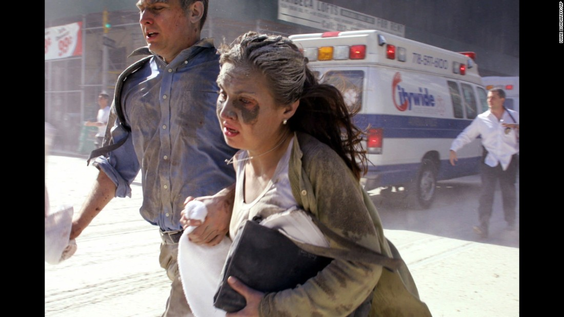 Dust-covered survivors run through New York's streets after the towers collapsed.