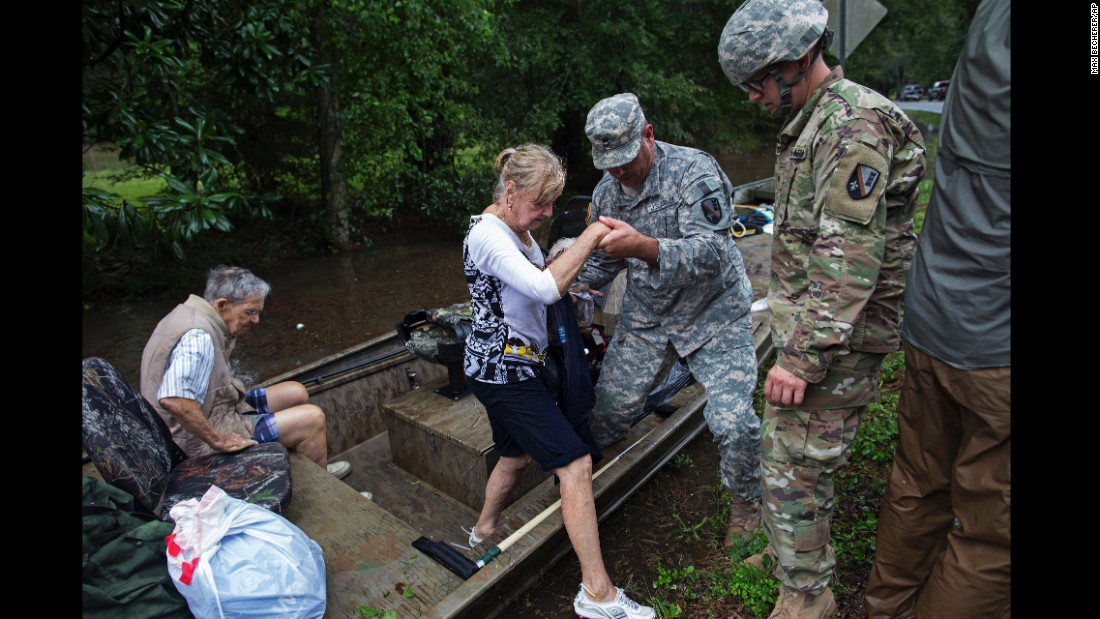Members of the Louisiana Army National Guard help people near Walker on August 14.