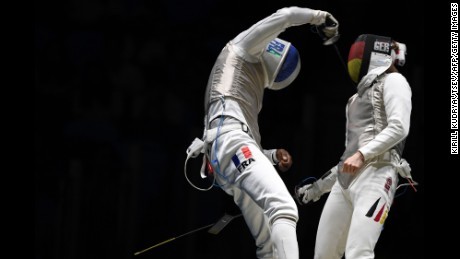 Germany's Peter Joppich (R) competes against France's Enzo Lefort during their mens individual foil qualifying bout as part of the fencing event  on August 7, 2016, at the Carioca Arena 3.