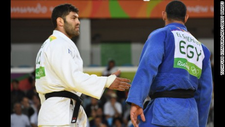 Egypt's Islam El Shehaby, blue, declined to shake hands with Israel's Or Sasson, white, after losing during the men's over 100-kg judo competition at the Rio Olympic Games on Friday, August 12.