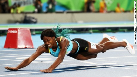 RIO DE JANEIRO, BRAZIL - AUGUST 15:  Shaunae Miller of the Bahamas dives over the finish line to win the gold medal in the Women's 400m Final on Day 10 of the Rio 2016 Olympic Games at the Olympic Stadium on August 15, 2016 in Rio de Janeiro, Brazil.  (Photo by Alexander Hassenstein/Getty Images)