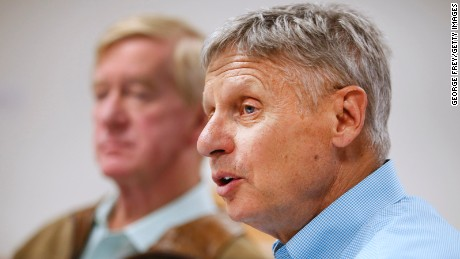 Libertarian presidential candidate Gary Johnson (R), and his running mate Bill Weld (L), talk to the press before a rally on August 6, 2015 in Salt Lake City, Utah.