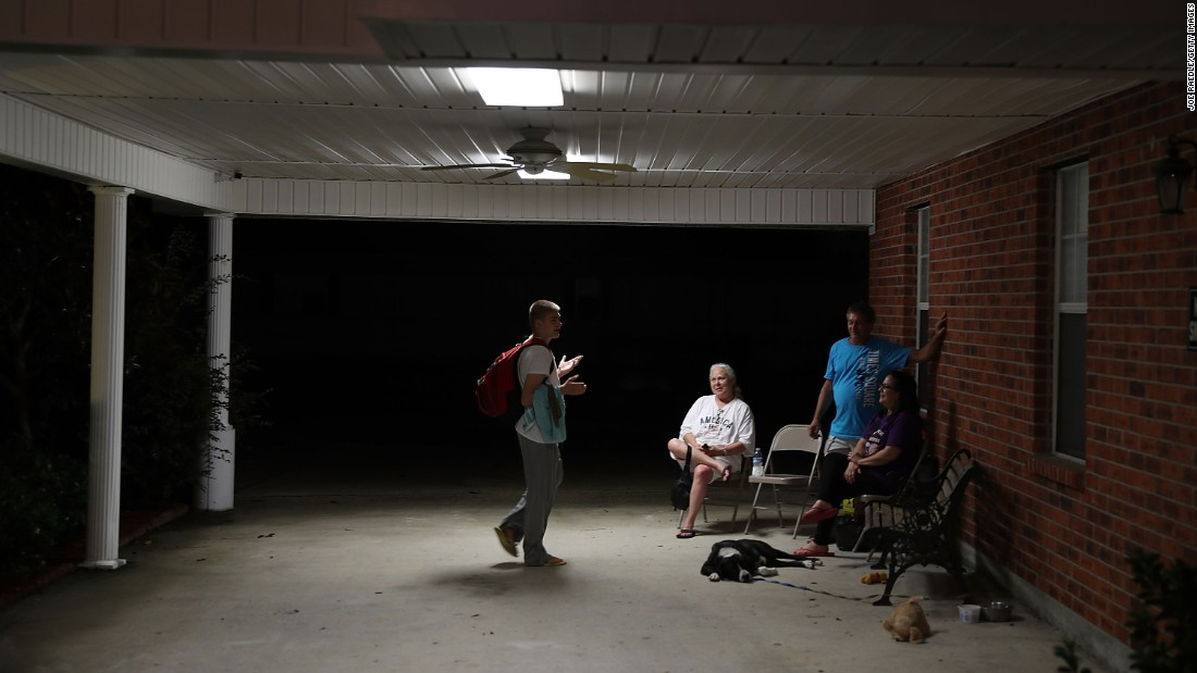 Evacuees spend time together at the church shelter in Walker on August 15.