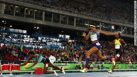 Shaunae Miller dives over the finish line to win the gold medal in the women's 400-meter final ahead of  Allyson Felix of the United States.