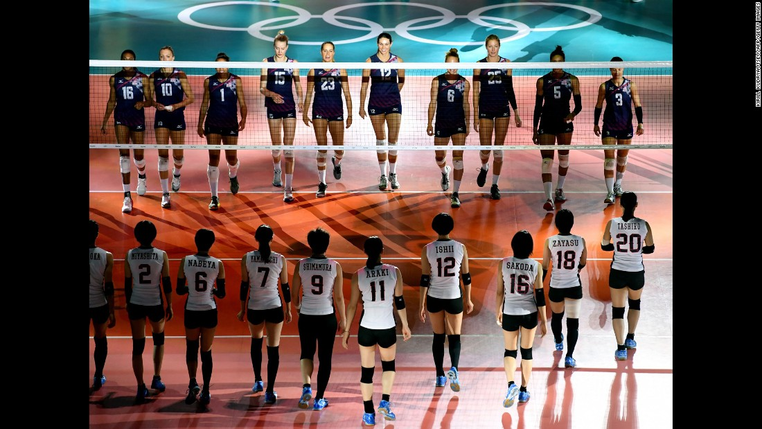 Volleyball teams from Japan and the United States wait for the start of their quarterfinal match.