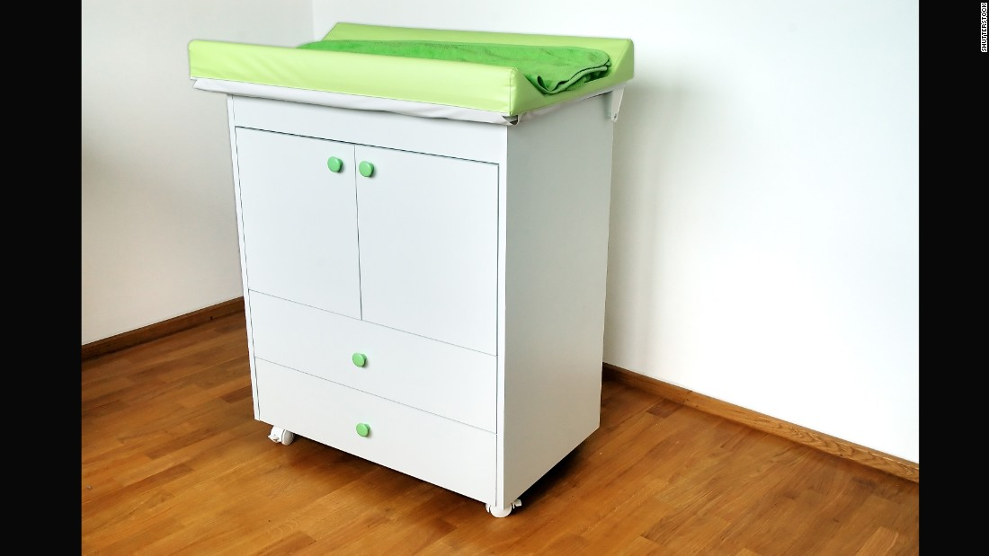 "Changing tables, like all large furniture items, should be <a href=""https://www.healthychildren.org/English/safety-prevention/at-home/Pages/Preventing-Furniture-and-TV-Tip-Overs.aspx"" target=""_blank"">anchored to walls to prevent tipping</a>. The American Academy of Pediatrics urges parents to <a href=""https://www.healthychildren.org/English/safety-prevention/at-home/Pages/Changing-Table-Safety.aspx"" target=""_blank"">never step away from a baby on a changing table</a>, even if the child is buckled or seems too young to roll."
