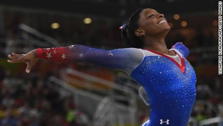 US gymnast Simone Biles competes in the women's floor event final of the Artistic Gymnastics at the Olympic Arena during the Rio 2016 Olympic Games in Rio de Janeiro on August 16, 2016.