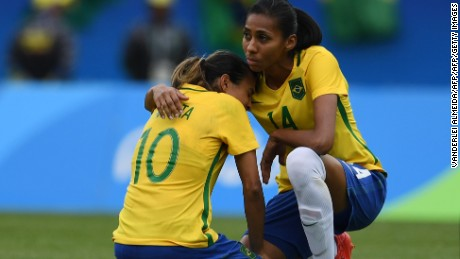 Marta is consoled by teammate Bruna after Sweden knocks Brazil out of the Olympic football tournament.