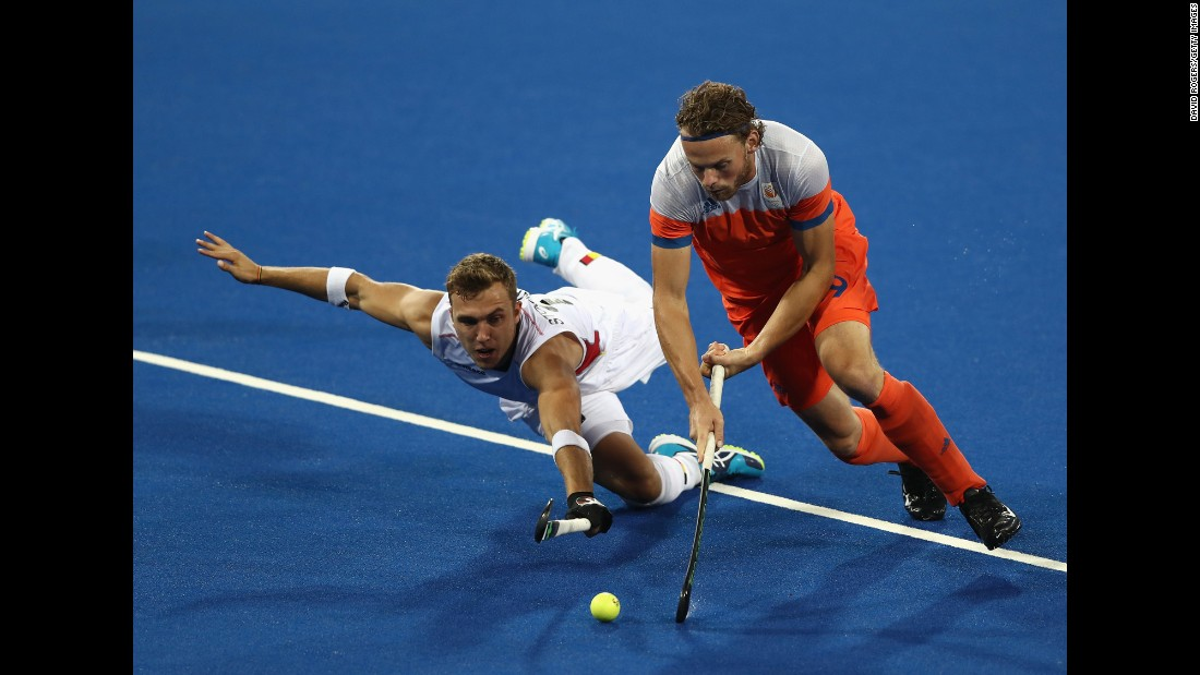 Dutch field hockey player Bob de Voogd, right, is challenged by Belgium's Emmanuel Stockbroekx during a semifinal match. Belgium won 3-1 to advance to the final against Argentina.