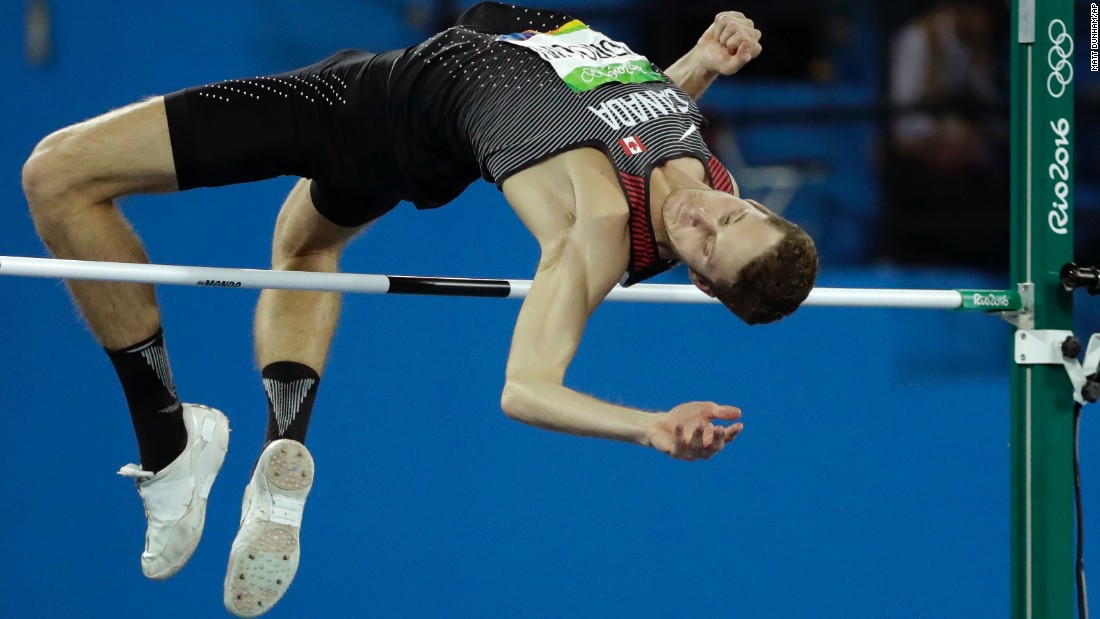 Canada's Derek Drouin clears the bar on his way to winning gold in the high jump on Tuesday, August 16.