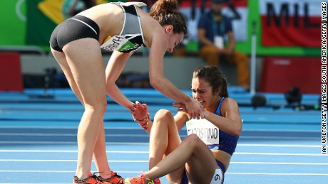 RIO DE JANEIRO, BRAZIL - AUGUST 16:  Abbey D'Agostino of the United States (R) is assisted by Nikki Hamblin of New Zealand after a collision during the Women's 5000m Round 1 - Heat 2 on Day 11 of the Rio 2016 Olympic Games at the Olympic Stadium on August 16, 2016 in Rio de Janeiro, Brazil.  (Photo by Ian Walton/Getty Images)