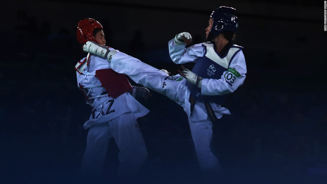 Ainur Yesbergenova of Kazakhstan, left, and Croatia's Lucija Zaninovic compete in a taekwondo bout.