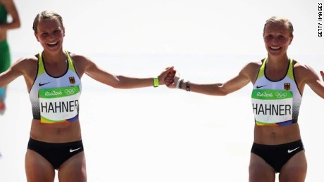 Olympic twins rebuked for finishing race holding hands