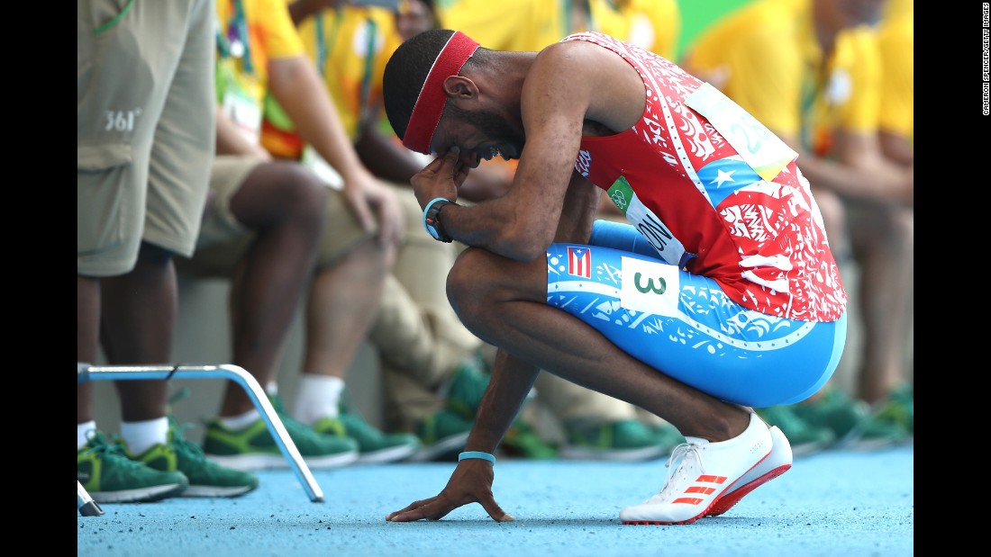Puerto Rico's Javier Culson reacts after being disqualified in the 400-meter hurdles final.