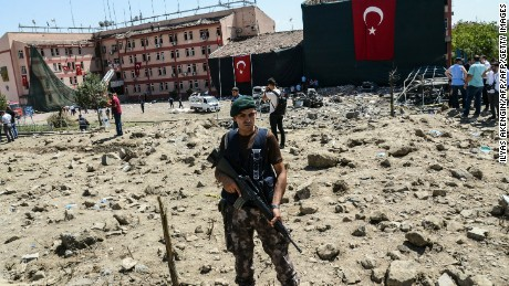 A Turkish soldier stands guard at the scene of the blast in Elazig.