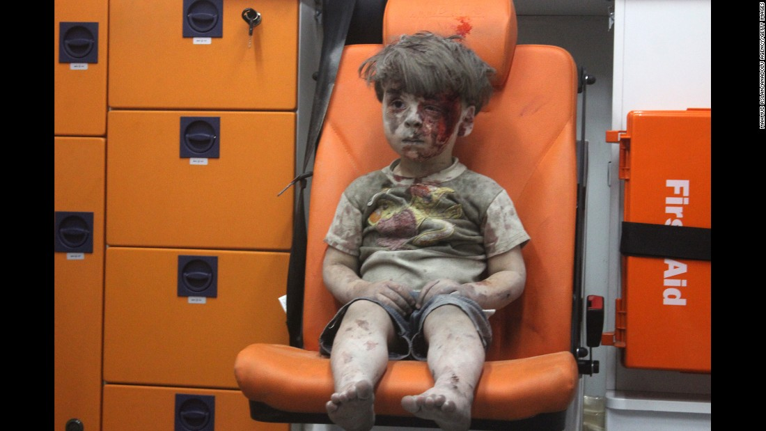 "This still image, taken from a video posted by the Aleppo Media Center, shows a young boy in an ambulance after an airstrike in Aleppo, Syria, on Wednesday, August 17. It took nearly an hour to dig the boy, <a href=""http://www.cnn.com/2016/08/17/world/syria-little-boy-airstrike-victim/index.html"" target=""_blank"">identified as Omran Daqneesh,</a> out from the rubble, an activist told CNN. The airstrike destroyed his home, where he lived with his parents and two siblings. Director of the Aleppo Media Center Yousef Saddiq said Omran's 10-year-old brother, Ali, <a href=""http://www.cnn.com/2016/08/20/middleeast/syria-conflict/index.html"" target=""_blank"">died from his injuries</a> on Saturday, August 20."
