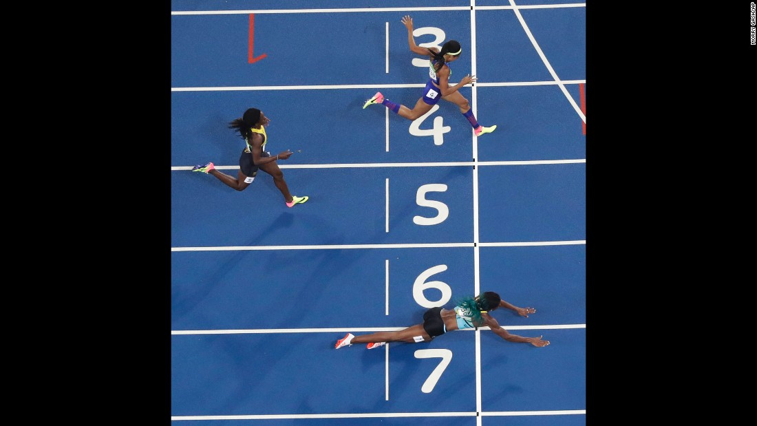 "Shaunae Miller of the Bahamas <a href=""http://www.cnn.com/2016/08/15/sport/allyson-felix-athletics-olympics/index.html"" target=""_blank"">dives over the finish line</a> to win gold in the 400 meters on Monday, August 15. She edged American Allyson Felix by .07 seconds."