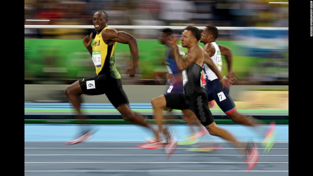 "<strong>August 14:</strong> Jamaican sprinter Usain Bolt looks back at his Olympic competitors during a 100-meter semifinal. Bolt <a href=""http://www.cnn.com/2016/08/14/sport/usain-bolt-justin-gatlin-olympic-games-100-meters-rio/"" target=""_blank"">won the final a short time later,</a> becoming the first man in history to win the 100 meters at three straight Olympic Games."