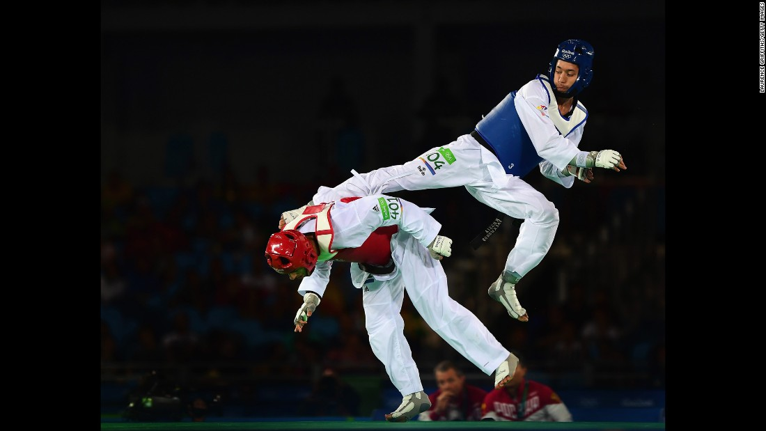 Russia's Alexey Denisenko kicks Belgium's Jaouad Achab during a taekwondo semifinal. Denisenko ended up with the silver medal.