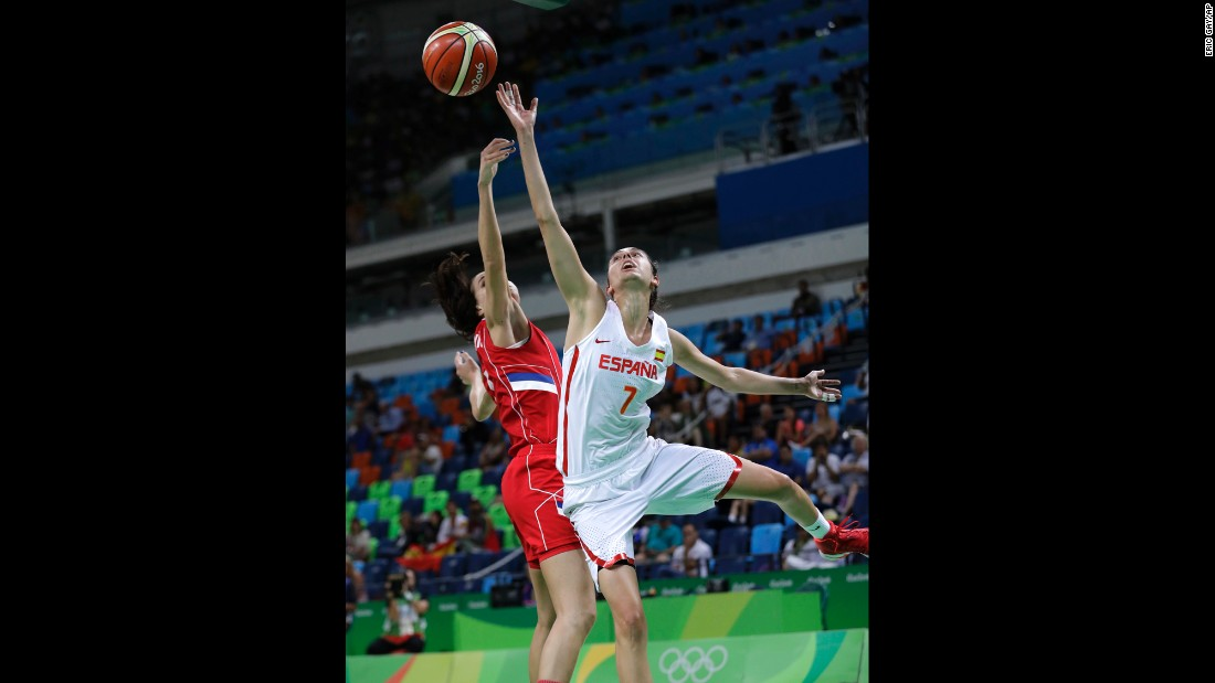 Spain's Alba Torrens, right, shoots over Serbia's Sonja Petrovic during a semifinal game. Spain won 68-54 and will play the United States in the final.