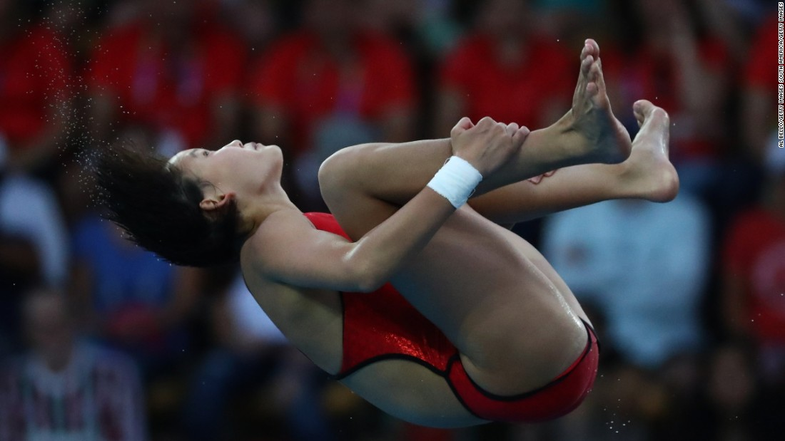 """Ren Qian: 15-year-old """"perfectionist"""" wins Olympic diving gold for China"""