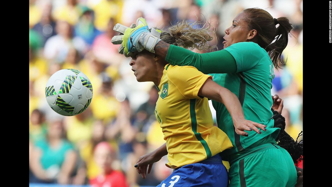 Brazilian goalkeeper Barbara collides with her teammate Monica during the bronze-medal match against Canada. Canada won 2-1.