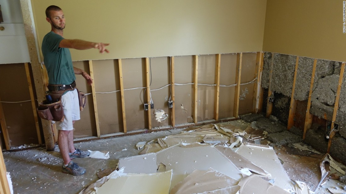 "Austin Schexnayder points to the black mold that is already forming along his home's baseboards. He lost just about everything in his four-bedroom, two-bathroom home. His insurance company called him Thursday, August 18, to tell him his $1,800-a-year policy didn't cover the destruction. ""It's scary, dude, the fact that we pay all this money and can't get no help at the end of it."""
