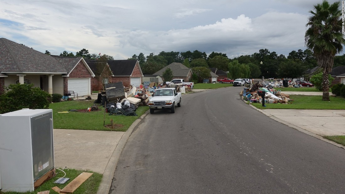 Though some homes were spared in the South Point neighborhood, many saw up to 4 feet of water. Evacuees couldn't reach their homes until four or five days after the flooding began. The scope of the destruction is evident in the debris piles in residents' yards, some of which sit 6 feet high taller. Everything from toys to appliances to official-looking documents to lingerie -- even a little pink bike with tassels on its handlebars -- can be found in the yards.