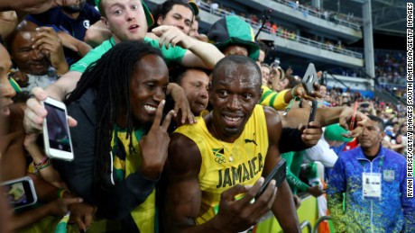 Fans' favorite: Usain Bolt takes time to pose for selfies after winning the 200-meters in Rio