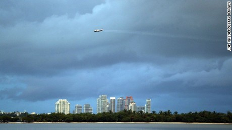 MIAMI, FL - AUGUST 12:  A plane sprays pesticide over parts of the city of Miami in the hope of controlling and reducing the number of mosquitos, some of which may be capable of spreading the Zika virus on August 12, 2016 in Miami, Florida. The CDC has advised pregnant women to avoid the Wynwood neighborhood of Miami where the majority of the 25 cases of people with the Zika virus have been found.  (Photo by Joe Raedle/Getty Images)