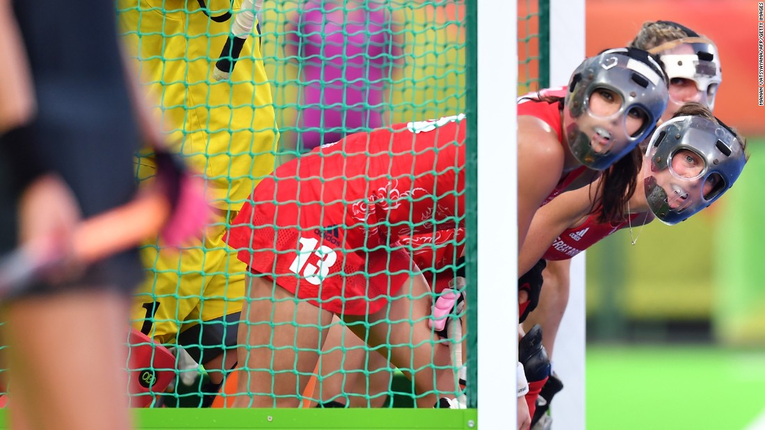 British field hockey players defend their goal during the gold-medal match against the Netherlands. Great Britain won in a shootout.