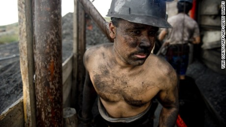 A Mexican miner emerges from a shaft in a coal mine in Agujita, Coahuila State in Mexico on November 13, 2012. According to the Mining Chamber of Mexico, the country produces annually 15 million tons of coal, with an average annual production worth USD 3,800 million, representing 1.6% of the country's Gross Domestic Product (GDP) . The bulk of the coal is used for power generation and steel production. Recent press reports affirm that drugs cartel are involved in the coal-related activities.   AFP PHOTO/YURI CORTEZ        (Photo credit should read YURI CORTEZ/AFP/Getty Images)