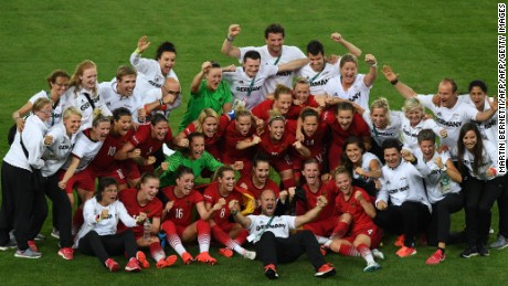 Germany's players, coaches and officials celebrate after their team's victory over Sweden after the Rio 2016 Olympic Games women's football final.