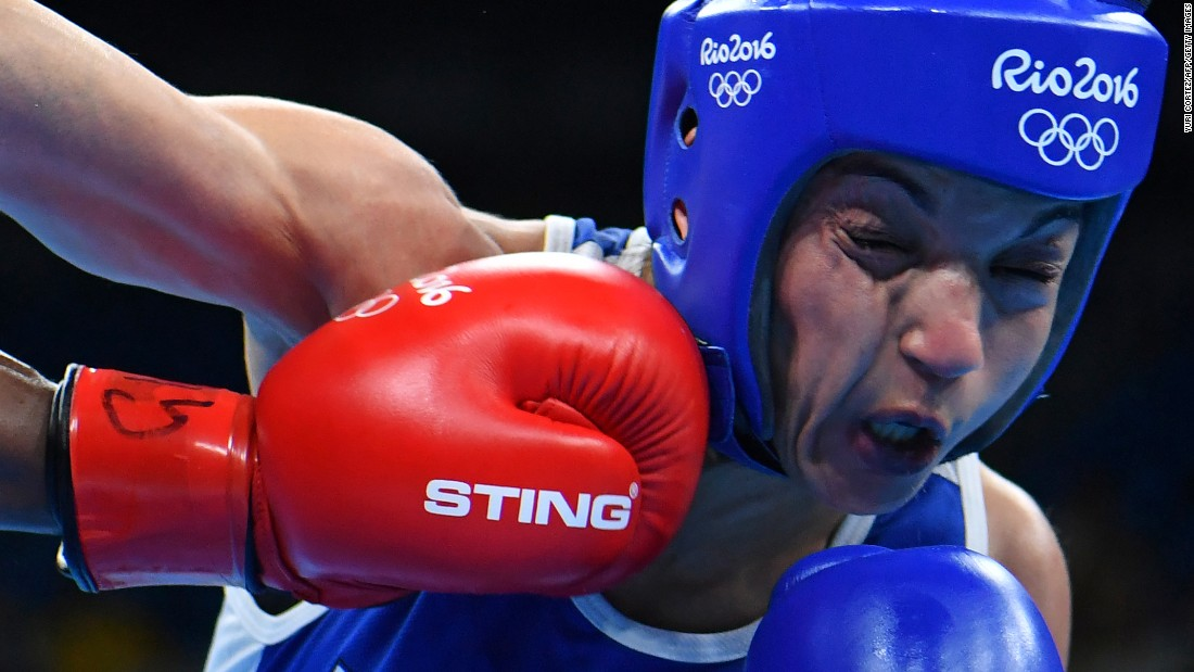 British boxer Nicola Adams, left, punches Sarah Ourahmoune of France during their flyweight 51-kilogram (112-pound) final bout.
