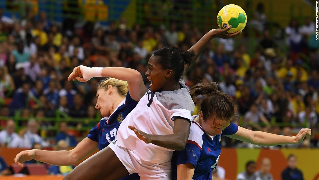 French handball player Gnonsiane Niombla, center, shoots the ball during the gold medal match against Russia. The Russians came out on top.