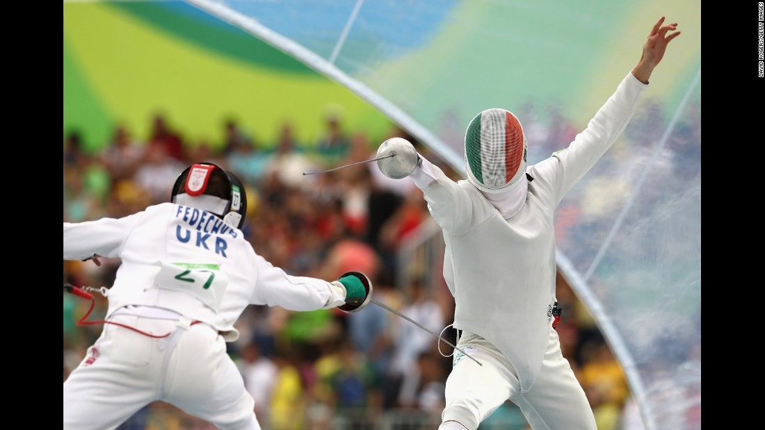 Ukraine's Andriy Fedechko, left, and Ireland's Arthur Lanigan-O'Keeffe take part in the fencing round of the modern pentathlon.