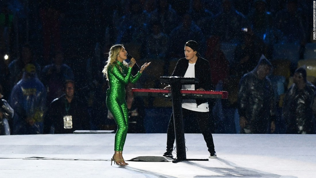 "Singer-songwriter Julia Michaels and electronic music artist Kygo perform the song ""Carry Me."""